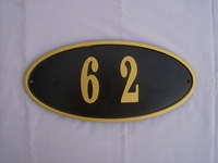 Sand Cast Aluminum Oval Address Plaque, Powder Coated Black, Trimmed with Gold Paint and Custom Numbered with Gold Painted Aluminum Numbers