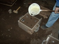 Pouring Metal into the Sand Cast Mold for Mailbox Top Cover Ball Accessory